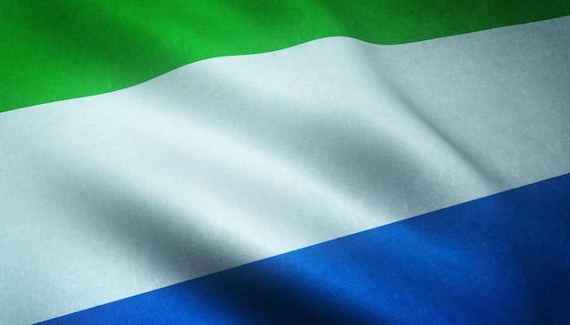 興味深いテクスチャとシエラレオネの旗を振っているのクローズアップショット 無料写真