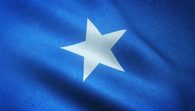 興味深いテクスチャでソマリアの手を振っている旗のクローズアップショット 無料写真