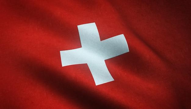 興味深いテクスチャとスイスの手を振る旗のクローズアップショット 無料写真