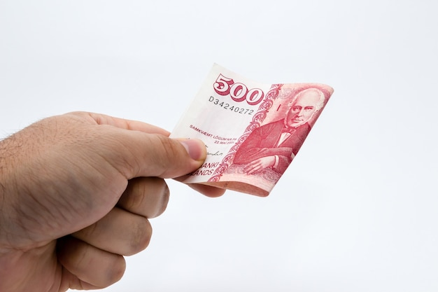 Closeup shot of a person holding some cash over a white Free Photo