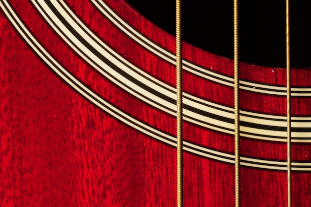 Closeup shot of red guitar body Free Photo