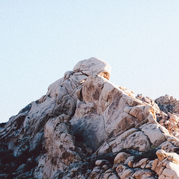Closeup shot of rock formations under a clear sky Free Photo