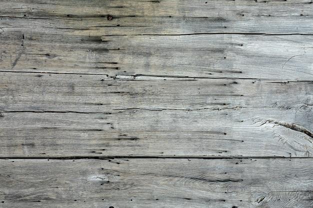 Colpo del primo piano di diversi pezzi di legno grigio uno accanto all'altro Foto Gratuite