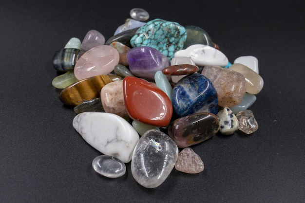 Closeup shot of various polished natural mineral stones against a black background Free Photo