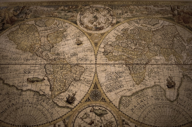 Closeup shot of a vintage world map made with puzzles Free Photo