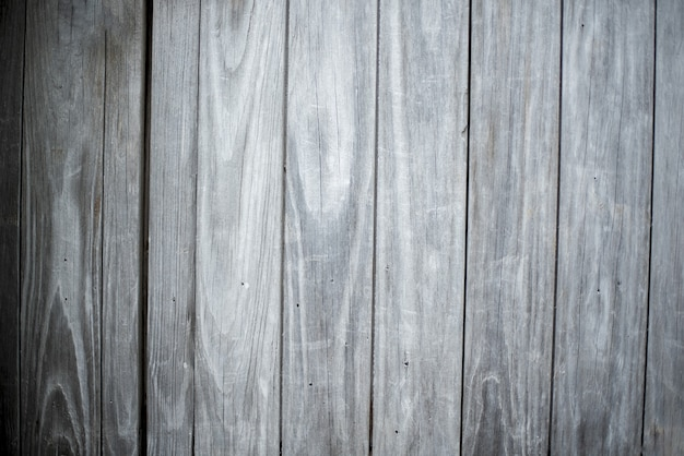 Closeup shot of a wall made of vertical gray wooden planks background Free Photo