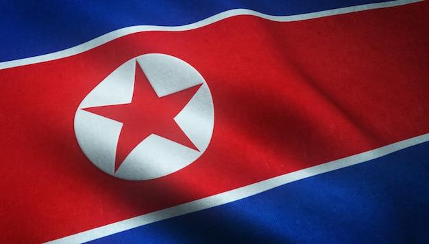 Colpo del primo piano della bandiera sventolante della corea del nord con trame interessanti Foto Gratuite