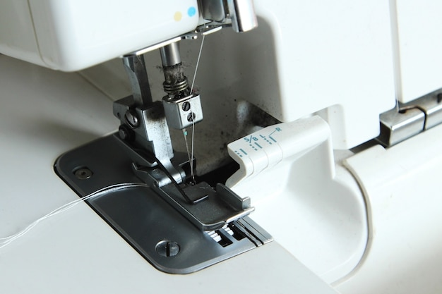 Closeup shot of a white sewing machine Free Photo