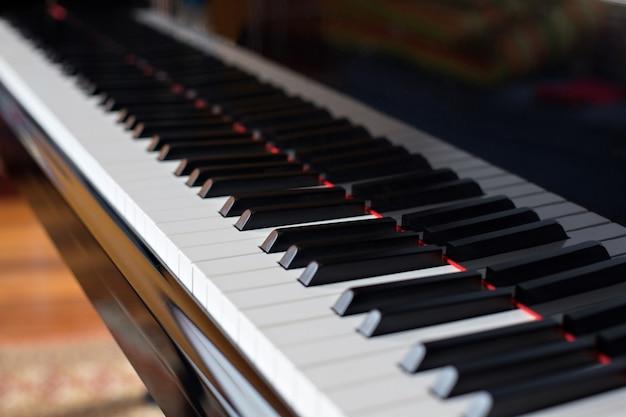 Closeup side view of piano Premium Photo