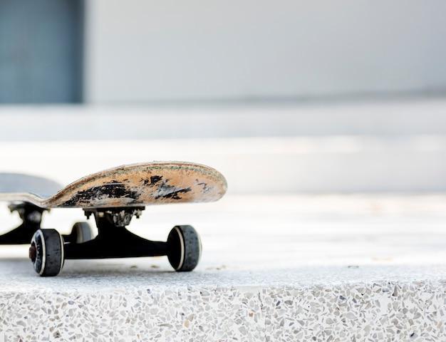 Closeup of skateboard on white floor Free Photo