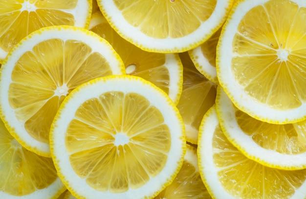 Closeup of slices of lemon textured background Free Photo