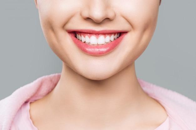 Closeup of smile with white healthy teeth. Premium Photo