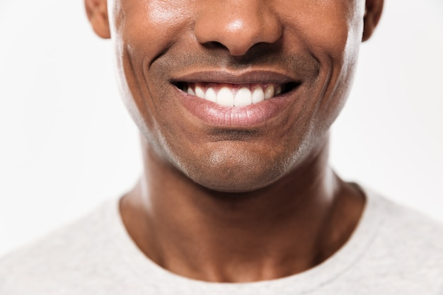 Closeup smile of a young cheerful african man Free Photo