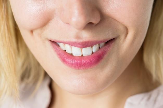 Closeup of smiling woman's teeth Premium Photo