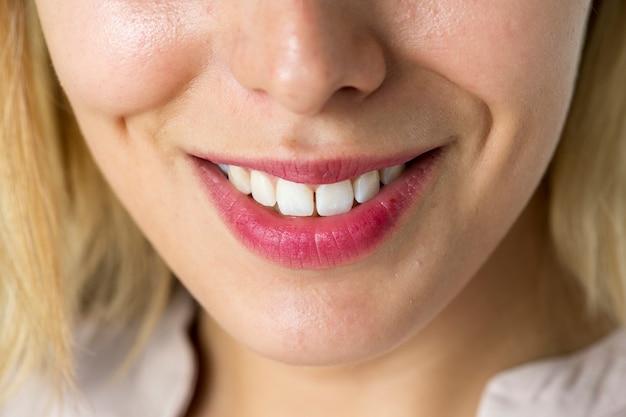 Closeup of smiling woman teeth Premium Photo