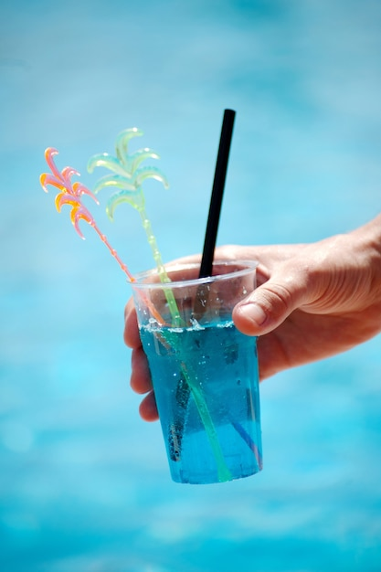 Closeup of a soft cocktail on the background of a pond Premium Photo