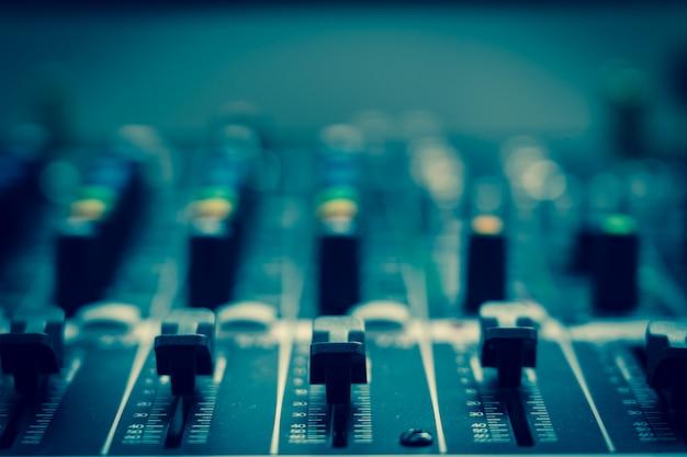 Closeup some part of audio mixer, vintage film style, music equipment concept Premium Photo