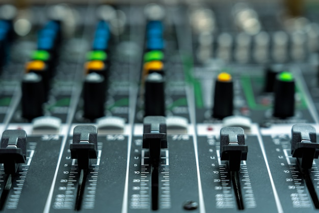 Closeup some part of audio mixer, vintage film style, music equipment concept Premium Photo