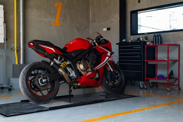 Closeup sport motorcycle in repair station and body shop Premium Photo