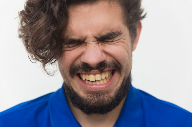 Closeup of stressed unhappy male face Free Photo