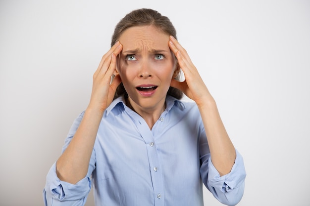 Closeup of stressed young woman rolling eyes Free Photo