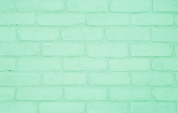 Closeup surface green brick wallpaper wall textured background Premium Photo