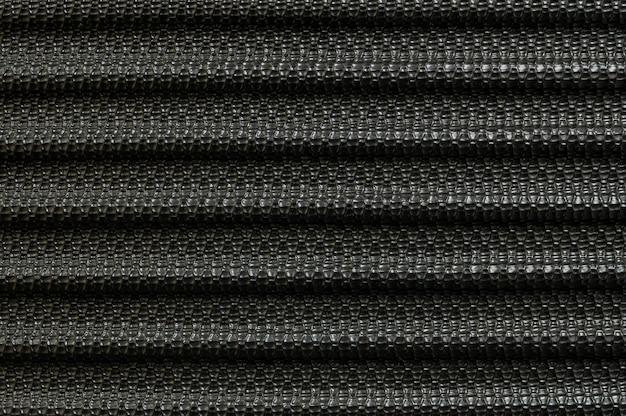 Closeup surface old black fiber at luggage texture background Premium Photo