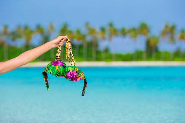 Closeup swimsuit on background of turquoise water and palmtrees Premium Photo