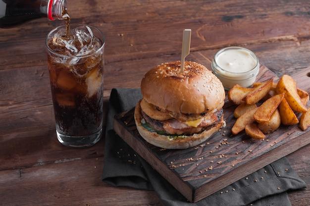 Closeup of a tasty burger with snacks. Premium Photo