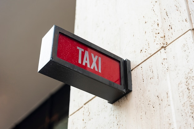 Closeup taxi sign outside building Free Photo
