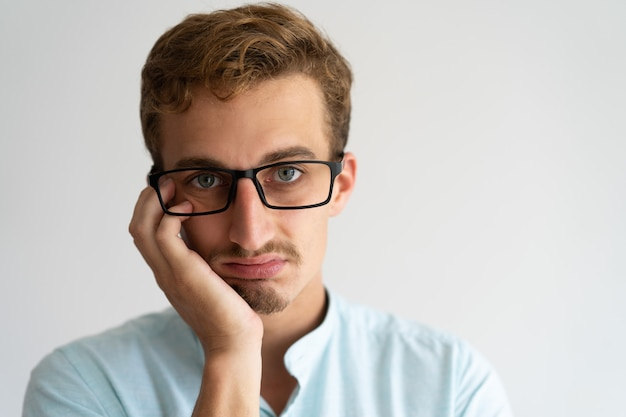 Closeup of upset annoyed blonde guy with disgusted face. Free Photo