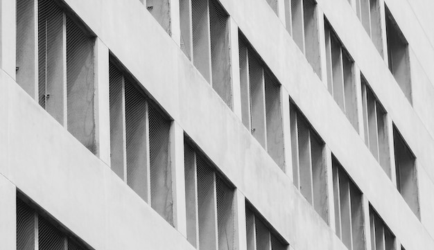 Closeup ventilated facade of concrete building. white building. architecture abstract background. Premium Photo