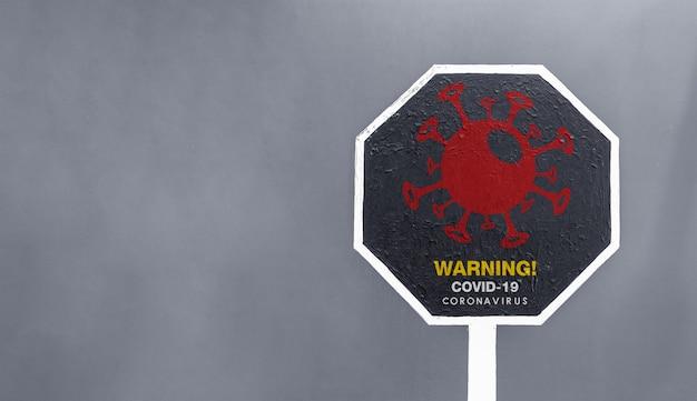 Closeup warning covid-19 sign Premium Photo