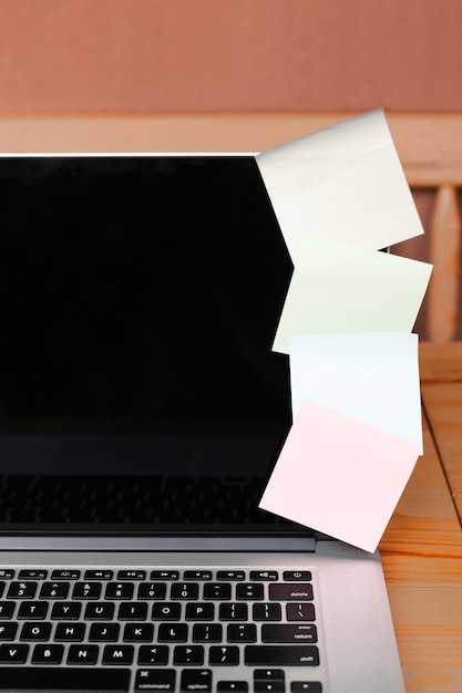 Closeup with laptop and sticky notes Free Photo