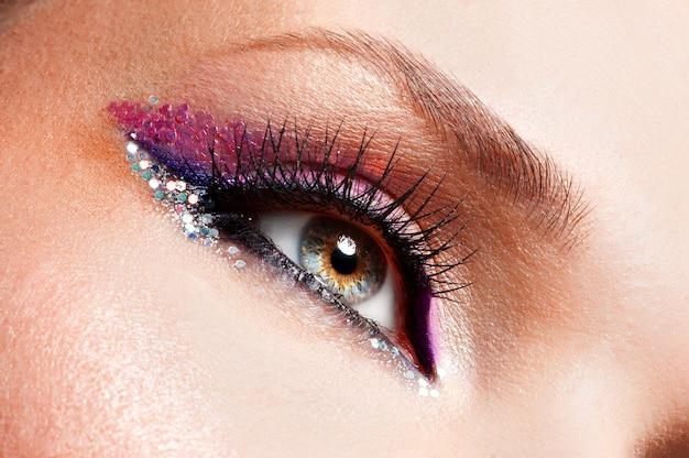 Closeup woman eyes with beautiful fashion bright pink make-up Free Photo