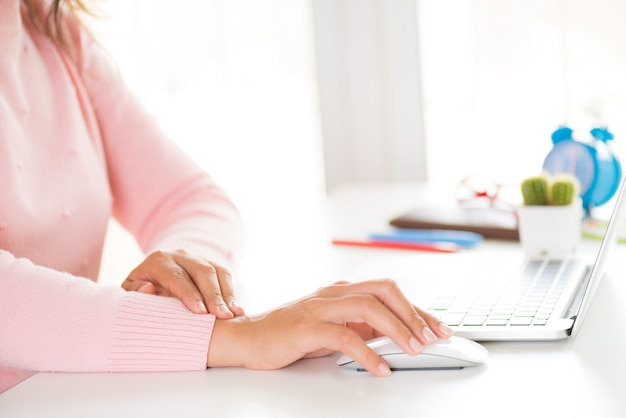 Closeup woman holding her wrist pain from using computer. office syndrome Premium Photo