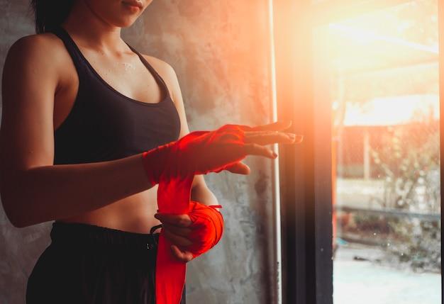Closeup of women hand fist red bandage. Premium Photo