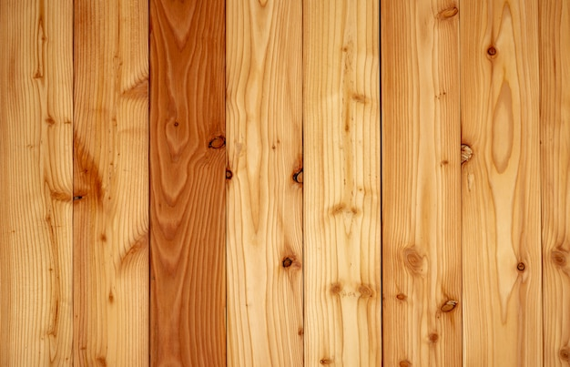 Closeup yellow wood texture background. wood texture with unique pattern.empty brown wooden wall. Premium Photo
