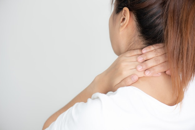 Closeup of young woman have neck and shoulder pain Premium Photo