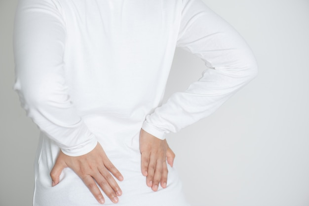 Closeup of young woman suffering from back pain Premium Photo