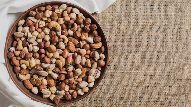 Cloth near bowl with nuts Premium Photo
