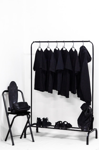 Clothes, bag and shoes all in black dressing room Premium Photo