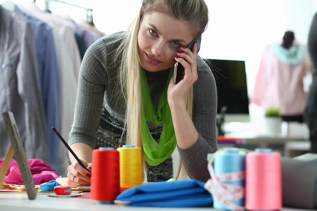 Clothes design and retail designer talking phone Premium Photo