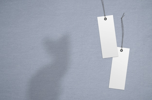 Clothes label tag on cloth background. branding template mockup Premium Photo