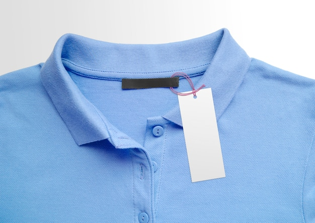 Clothes label tag on cloth background. branding template surface. color of the year 2020 classic blue Premium Photo