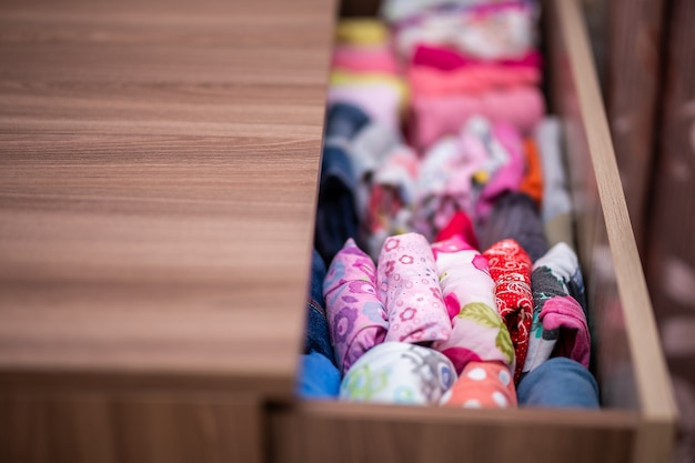 Clothing folded for vertical storage in the linen drawer Premium Photo