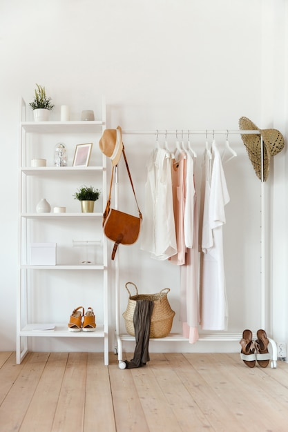 Clothing in trendy color hangs on a rack with accessories Premium Photo
