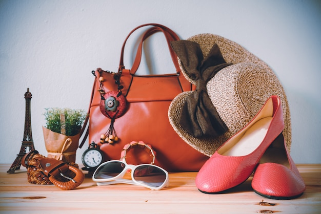 Clothing for women, placed on a wooden floor. Premium Photo