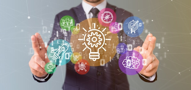 Cloud of colorfull start up icon bubble with data businessman holding a binary Premium Photo