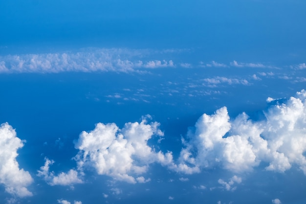 Cloud texture and blue sky view from airplane Premium Photo